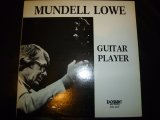 MUNDELL LOWE/GUITAR PLAYER